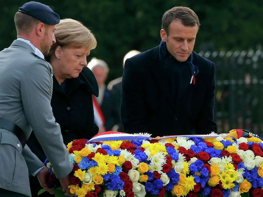 Image result for Merkel, Macron, Philippe Wojazer, november 10, 2018, photos
