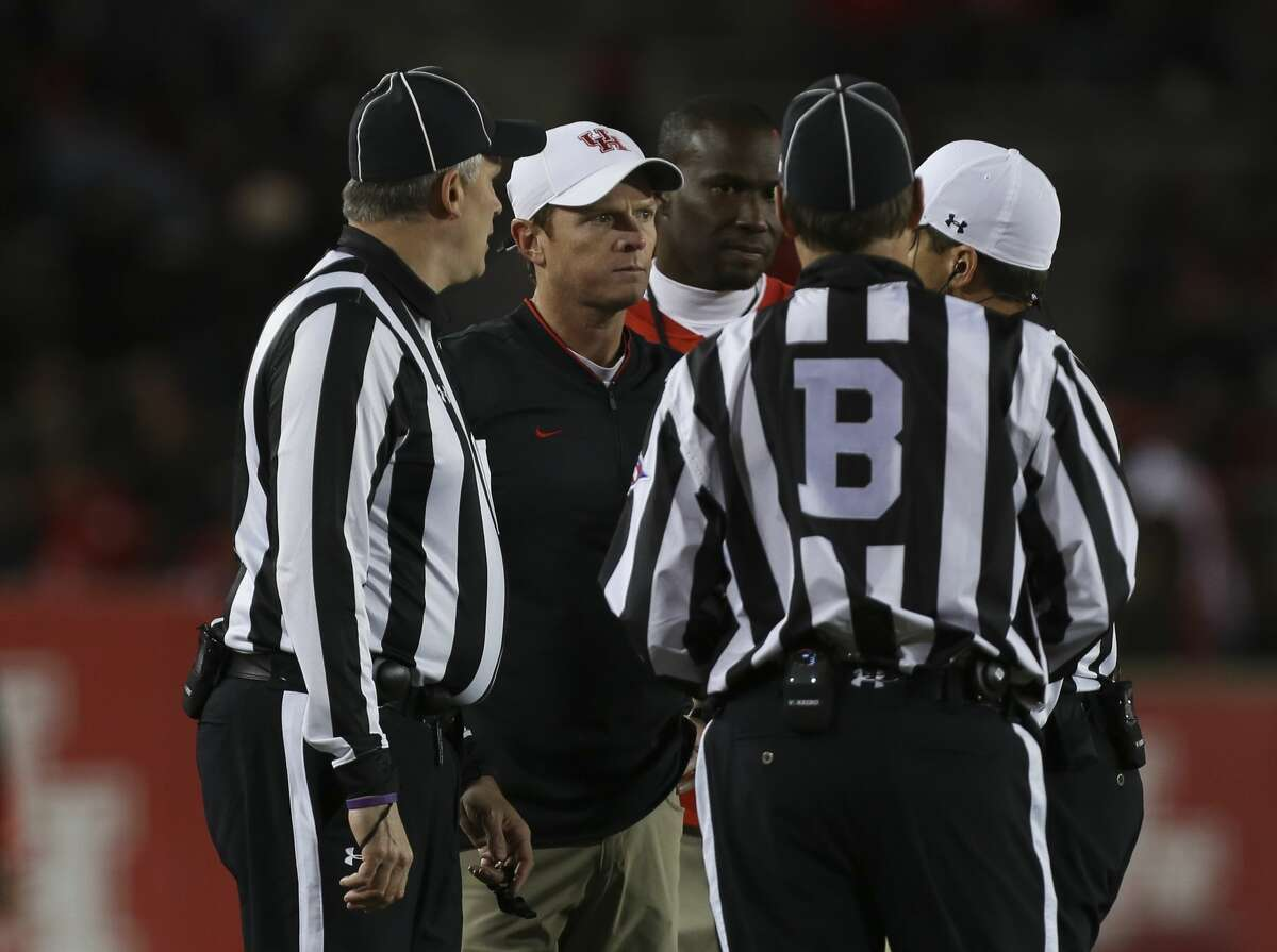 Houston Cougars head coach Major Applewhite talks to the referees during the second half of the game against the Temple Owls at TDECU Stadium on Saturday, Nov. 10, 2018, in Houston.