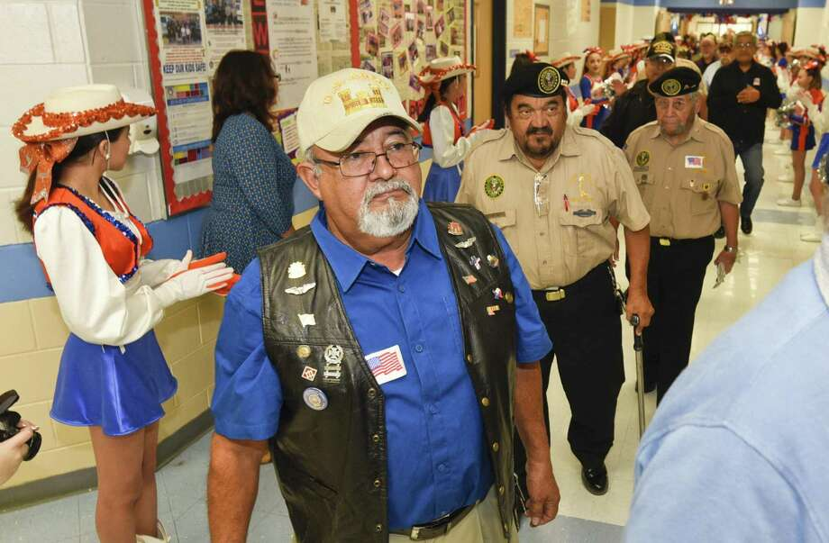 Veterans make their way to the Trautmann Middle School gym on Monday for the Veteran's Day Ceremony where students honored those who have served in the military. Photo: Danny Zaragoza /Laredo Morning Times / Laredo Morning Times