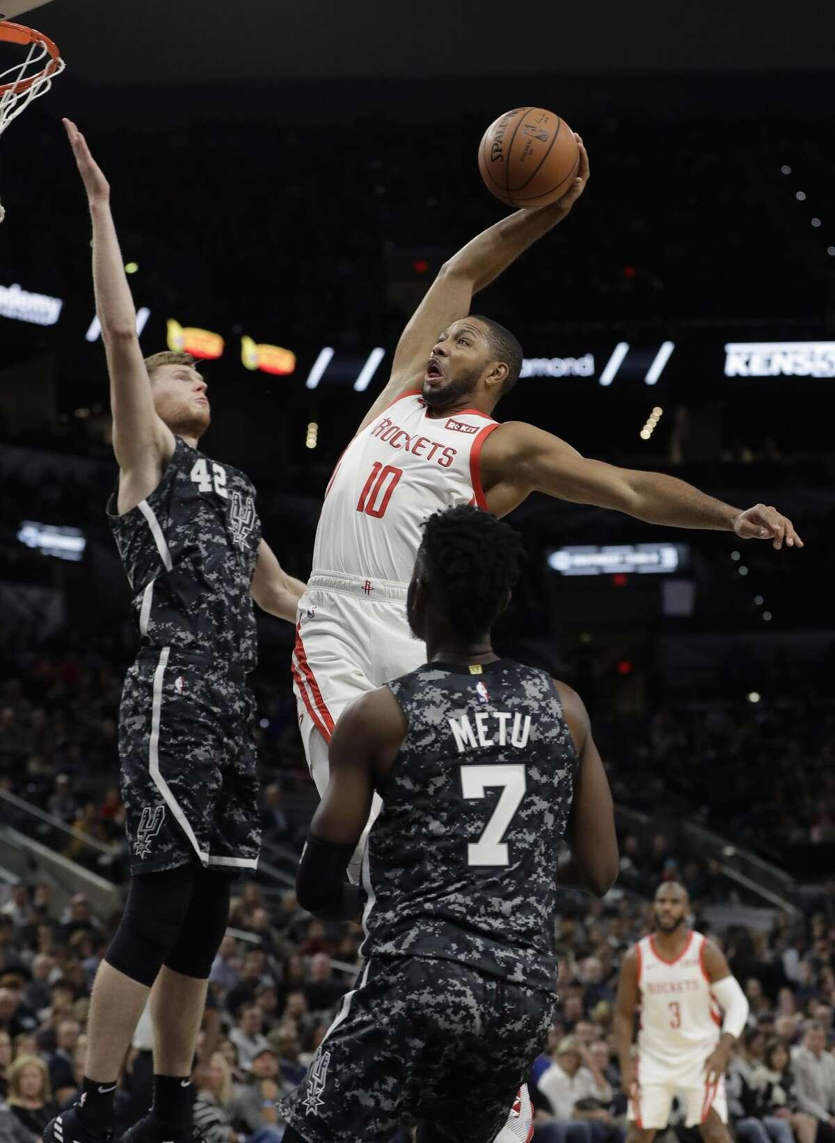 Houston Rockets guard Eric Gordon (10) scores over San Antonio Spurs forward Davis Bertans (42) during the first half of an NBA basketball game, Saturday, Nov. 10, 2018, in San Antonio. (AP Photo/Eric Gay)