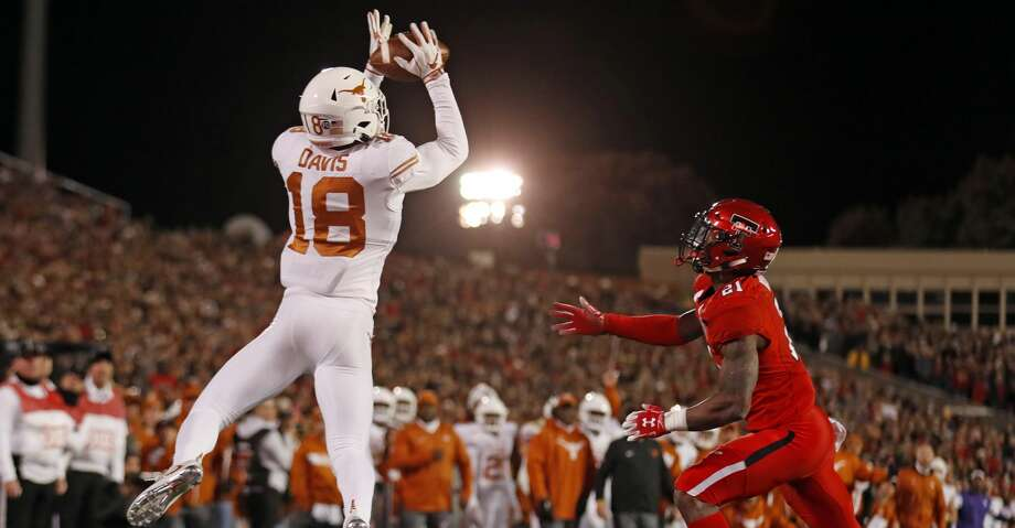 Texas' Davante Davis (18) intercepts a pass in the end zone during the first half of an NCAA college football game against Texas Tech, Saturday, Nov. 10, 2018, in Lubbock, Texas. (AP Photo/Brad Tollefson) Photo: Brad Tollefson/Associated Press