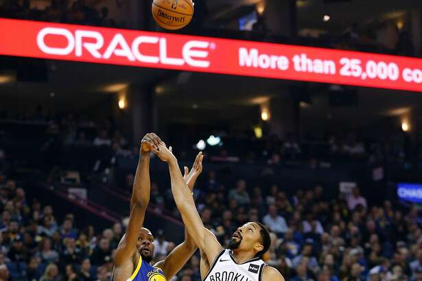Golden State Warriors forward Kevin Durant (35) makes the shot against Brooklyn Nets guard Spencer Dinwiddie (8) in the second half of an NBA game at Oracle Arena on Saturday, Nov. 10, 2018, in Oakland, Calif. The Warriors won 116-100.
