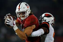 PALO ALTO, CA - NOVEMBER 10: Tight end Colby Parkinson #84 of the Stanford Cardinal catches a pass for a touchdown past cornerback Dwayne Williams #4 of the Oregon State Beavers during the first quarter at Stanford Stadium on November 10, 2018 in Palo Alto, California. (Photo by Jason O. Watson/Getty Images)