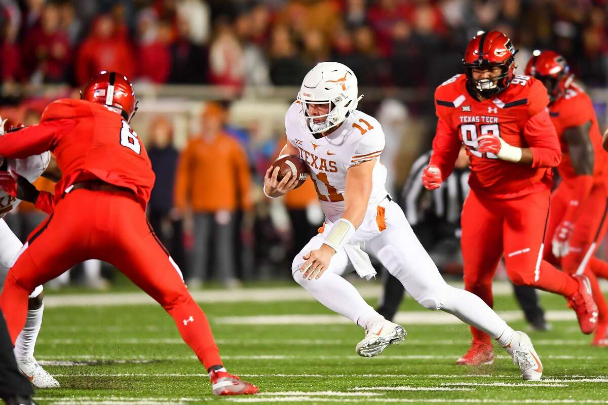 LUBBOCK, TX - NOVEMBER 10: Sam Ehlinger #11 of the Texas Longhorns runs with the ball during the first half of the game against the Texas Tech Red Raiders on November 10, 2018 at Jones AT&T Stadium in Lubbock, Texas. (Photo by John Weast/Getty Images)