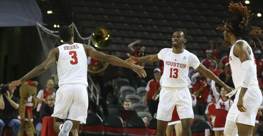 Houston Cougars guard Armoni Brooks (3) high-fives DeJon Jarreau (13) after scoring a relay slam dunk with Jarreau's pass during the second half of the game at H&PE Arena on Saturday, Nov. 10, 2018, in Houston. The Houston Cougars defeated the Alabama A&M Bulldogs 101-54. Photo: Yi-Chin Lee/Staff Photographer