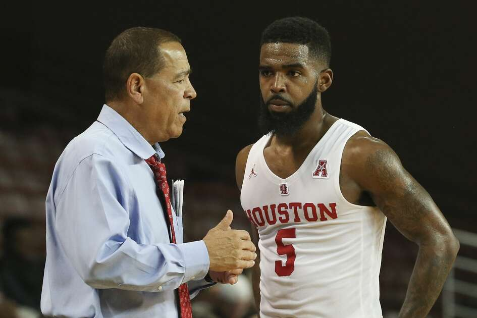 Houston Cougars Head Coach Kelvin Sampson talks to guard Corey Davis Jr. (5) during the second half of the game against the Alabama A&M Bulldogs at H&PE Arena on Saturday, Nov. 10, 2018, in Houston. The Houston Cougars defeated the Alabama A&M Bulldogs 101-54.