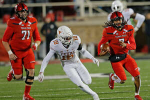 Texas Tech quarterback Jett Duffey (7) runs to daylight against the Texas Longhorns in Saturday night's Big 12 game at Lubbock's Jones AT&T Stadium. (Photo by Wade H Clay/Special to Reporter-Telegram)
