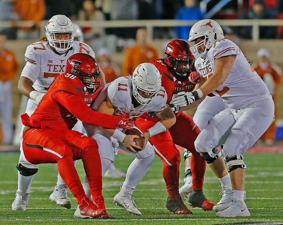 Texas quarterback Sam Ehlinger (11) is corralled by several Red Raider defenders in Saturday's Big 12 action at Lubbock's Jones AT&T Stadium. (Photo by Wade H Clay/Special to the Reporter-Telegram) Photo: Wade H Clay