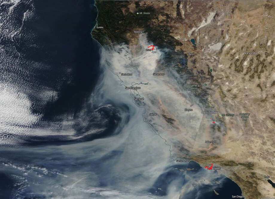 Satellite imagery from NASA's Earth Observing System Data and Information System shows smoke from California's Camp and Woolsey fires on Nov. 10, 2018. Photo: NASA EOSDIS