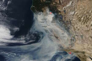 Satellite imagery from NASA'sEarth Observing System Data and Information System shows smoke from California's Camp and Woolsey fires on Nov. 10, 2018.
