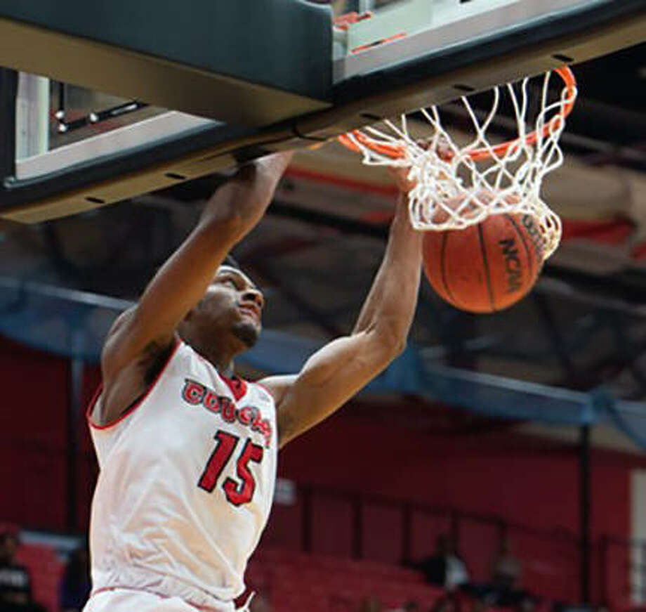 SIUE's David McFarland slams home two of his team-high 20 points in Saturday night's loss to Winthrop at the Vadalabene Center in Edwardsville. Photo: SIUE Athletics