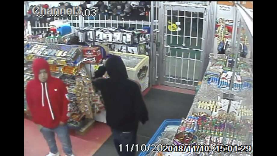 One of the suspects believed pictured in surveillance footage taken before the fatal shooting has been apprehended. Photo: Metro Video