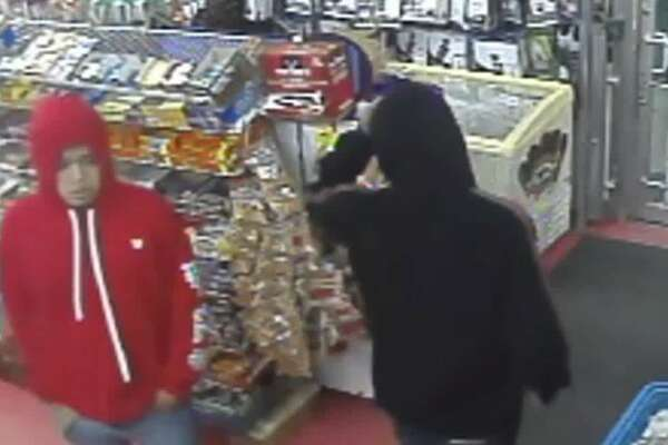 Police are asking for the pubilc's help in identifying the men accused of trying to rob a store and then fatally shooting the clerk.