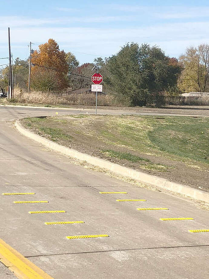 The newly installed rumble strips and solar-powered flashing stop sign at the corner of Rock Hill Road and Wesley Drive. Photo: For The Telegraph