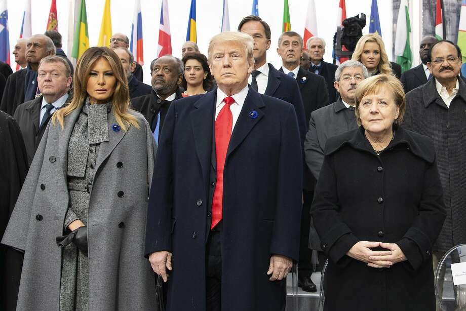 First lady Melania Trump, President Trump and German Chancellor Angela Merkel during the commemoration ceremony of the 100th anniversary since the end of The First World War on November 11, 2018 in Paris, France. Heads of State from around the world gather in Paris to commemorate the end of the First World War (WWI). The armistice ending the First World War between the Allies and Germany was signed at Compiègne, France on eleventh hour of the eleventh day of the eleventh month - 11am on the 11th November 1918. (Photo by Guido Bergmann/Bundesregierung via Getty Images) Photo: Handout / Getty Images