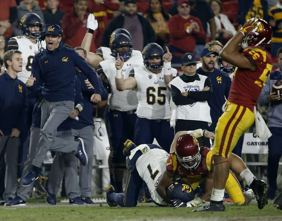 California head coach Justin Wilcox, left, leaps to celebrate a first down by quarterback Chase Garbers, center, by Southern California safety Marvell Tell III, second from right, as linebacker Jordan Iosefa, right, laments during the second half of an NCAA college football game in Los Angeles, Saturday, Nov. 10, 2018. California won 15-14. (AP Photo/Alex Gallardo) Photo: Alex Gallardo / Associated Press