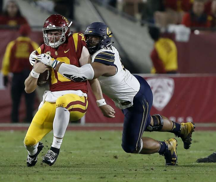 Southern California quarterback JT Daniels, left, is sacked by California defensive end Luc Bequette during the first half of an NCAA college football game in Los Angeles, Saturday, Nov. 10, 2018. (AP Photo/Alex Gallardo)