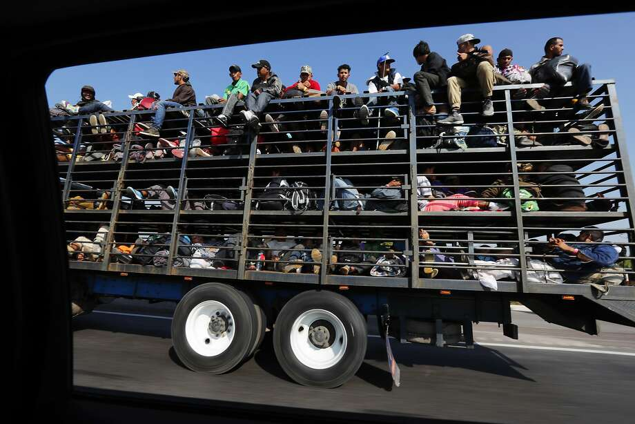 Central American migrants ride on a truck in Celaya, Mexico, on their way to the U.S. border. Photo: Marco Ugarte / Associated Press