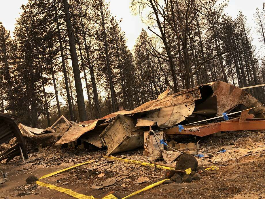 Caution tape outlines an area outside the mobile home lot of Paradise resident Vinnie Carota, whose family believes died in the Camp Fire. Photo: Melody Gutierrez / The Chronicle