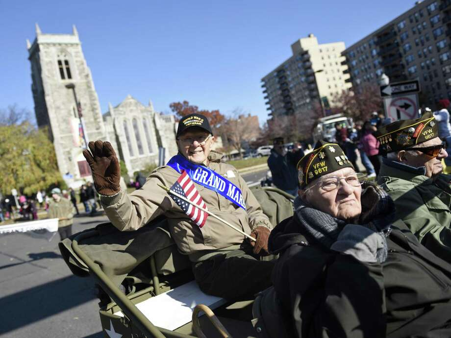 Army aircraft mechanic and flight engineer Sgt. Ted Ogonek, 92, waves to the crowd as grand marshal in the annual Stamford Veteran's Day Parade, commemorating 100 years since the end of WWI, in Stamford on Sunday. Photo: Tyler Sizemore / Hearst Connecticut Media / Greenwich Time