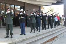 An honor guard fires a 21-gun salute.