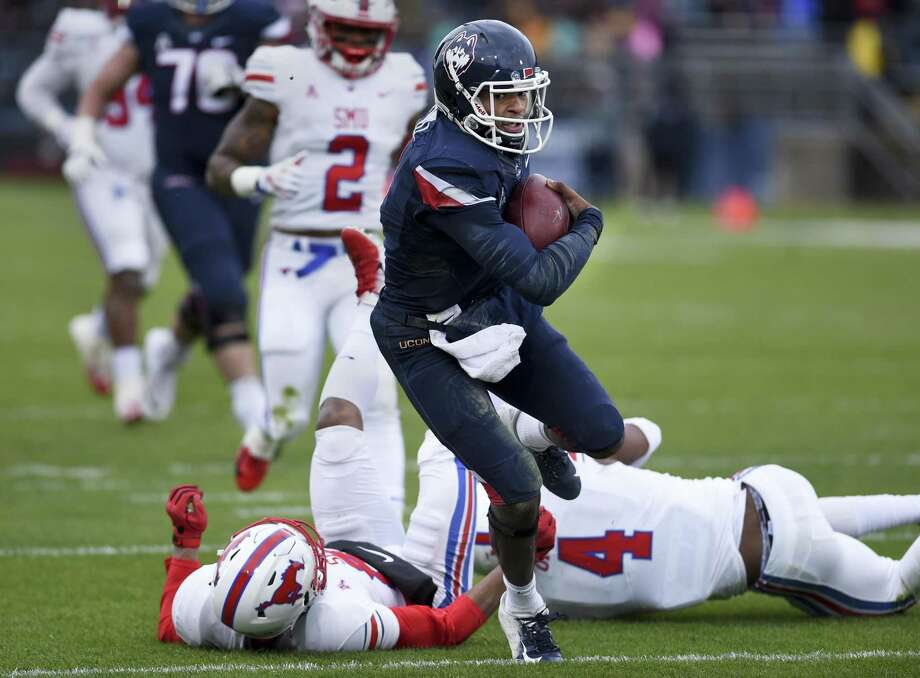 UConn quarterback David Pindell runs for a touchdown in the first half against SMU on Saturday. Photo: Stephen Dunn / Associated Press / Copyright 2018 The Associated Press. All rights reserved