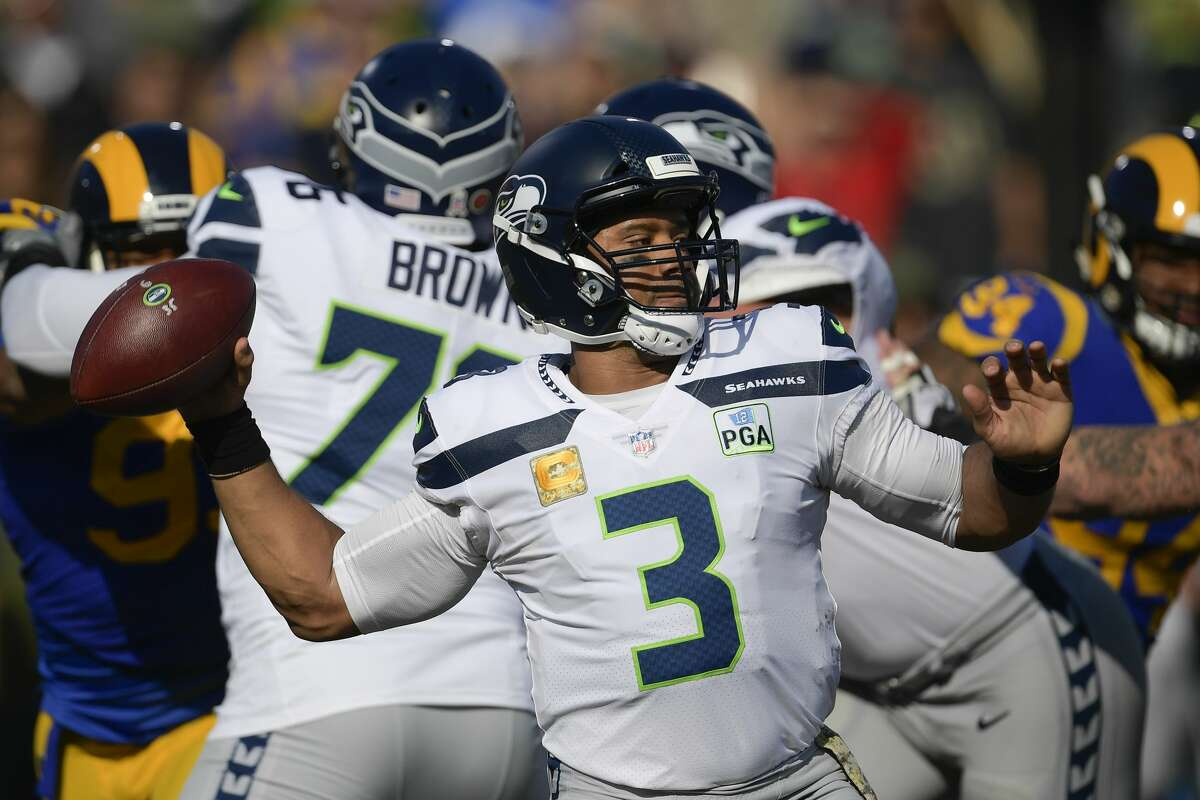 Seattle Seahawks quarterback Russell Wilson passes against the Los Angeles Rams during the first half in an NFL football game Sunday, Nov. 11, 2018, in Los Angeles. (AP Photo/Mark J. Terrill)