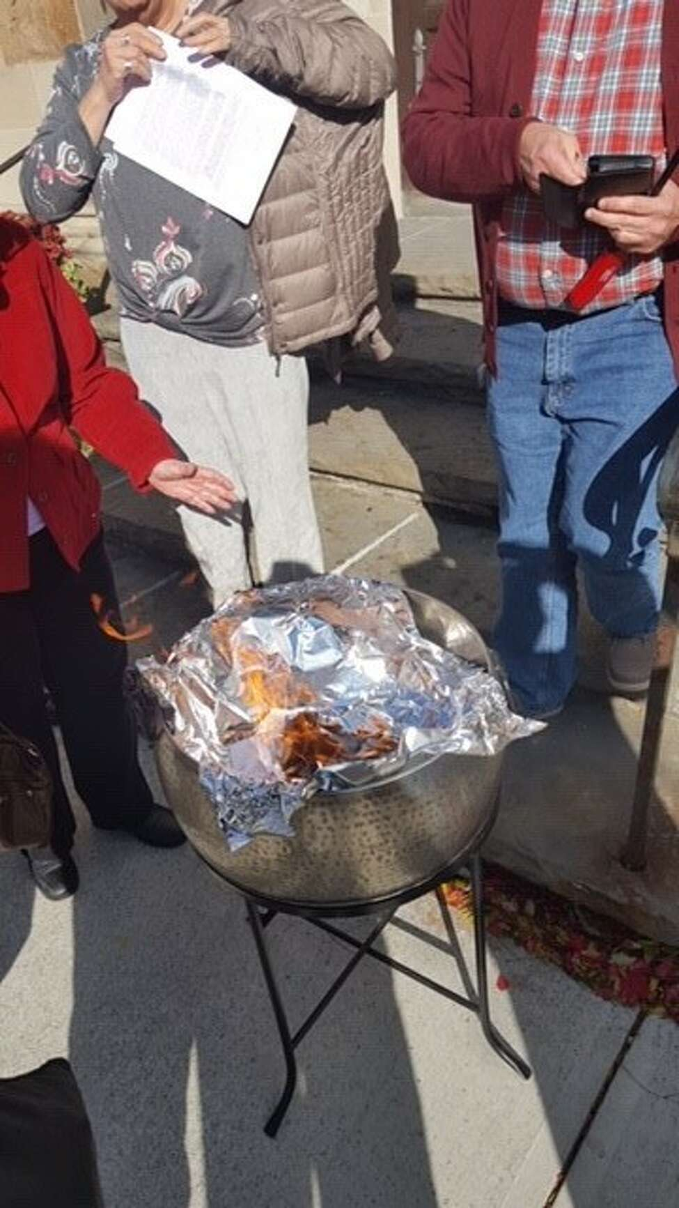 Parishioners at St. Andrew's in Albany said they ceremonially burned a copy of Bishop William Love's letter that banned same-sex marriage in the Albany Episcopal Diocese. The parishioners lit it on fire outside while it was being read inside St. Andrew's on Sunday, Nov. 11, 2018 at St. Andrew's Episcopal Church in Albany.