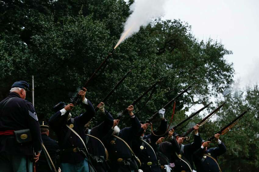 The Sons of Union Veterans of the Civil War and other reenactors fire off a volley as they deliver a 21 gun salute at the Houston Salutes American Heroes Veterans Day celebration Sunday, Nov. 11, 2018, in Houston honoring the 100th anniversary of the signing of the World War I Armistice.