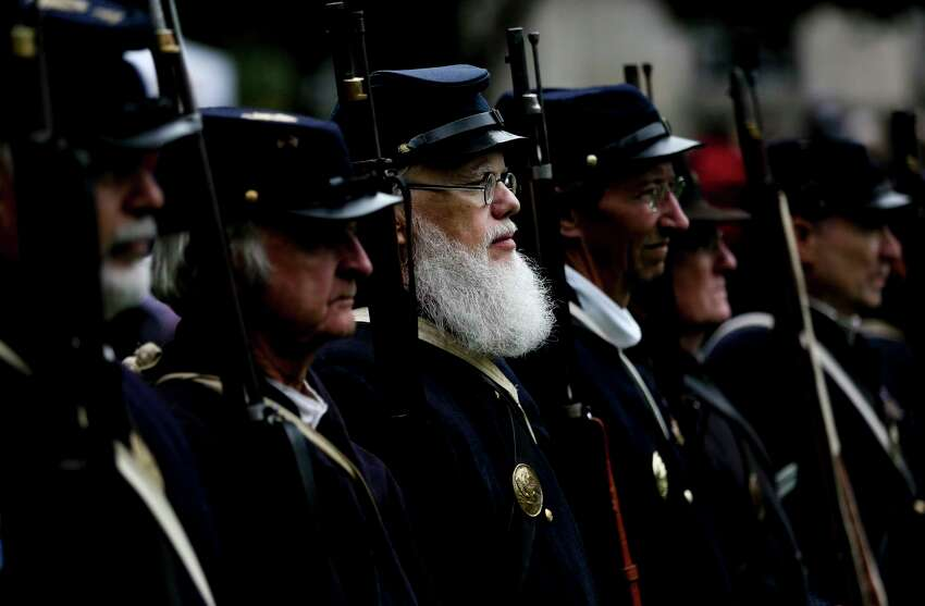 Harlan Low, center, stands at attention as he and other reenactors prepare to deliver a 21 gun salute at the Houston Salutes American Heroes Veterans Day celebration Sunday, Nov. 11, 2018, honoring the 100th anniversary of the signing of the World War I Armistice.