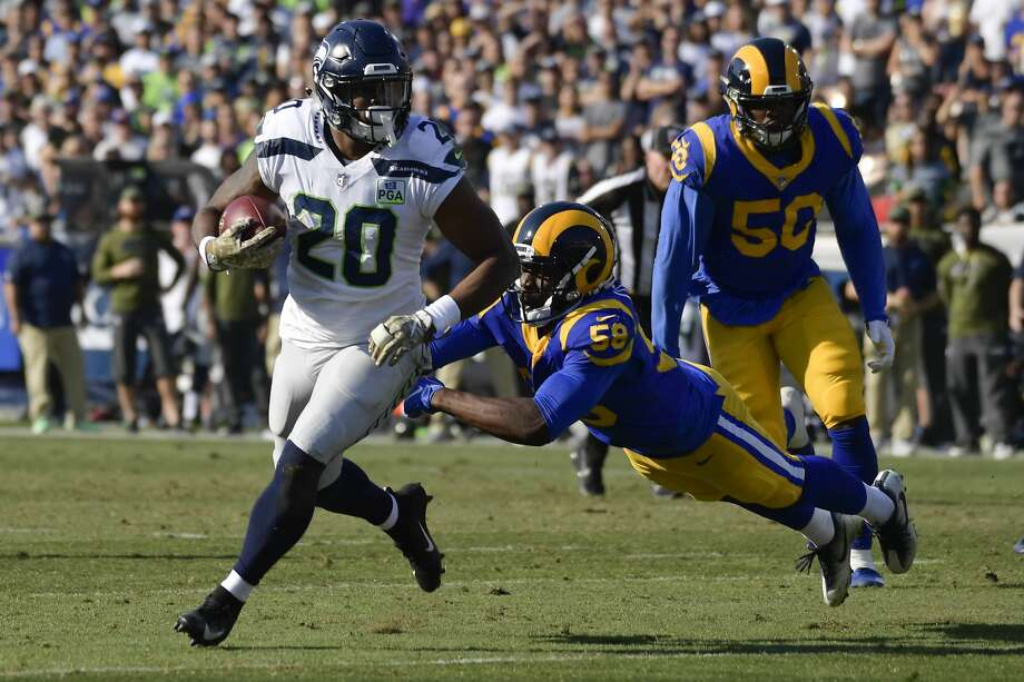 IMPROVEMENT FROM RASHAAD PENNY It was a year ago this time when running back Chris Carson reported back to the Seahawks for 2018 OTAs, opening eyes with the improvements he'd made to his physique and diet, following a rookie campaign cut short on IR. Carson went on to become Seattle's first 1,000-yard rusher in four years.  This time around, the focus on the backfield will be on 2018 first-round pick Rashaad Penny to make a jump of his own -- to put an inconsistent rookie year behind him. He never really seemed to find a rhythm in 2018 after battling injuries. Though there won't be live contact over the next three weeks, how Penny cuts and runs will be important to watch for.  If Penny has taken the Carson approach this offseason -- if he's more cut and chiseled from the 220 pounds we saw him as a a rookie -- that's a great development for the Seahawks, and potentially sets up a legitimate battle for RB1 with Carson as we approach the 2019 season.        Photo: Mark J. Terrill/AP