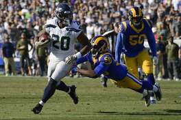 Seattle Seahawks running back Rashaad Penny scores past Los Angeles Rams inside linebacker Cory Littleton during the first half in an NFL football game Sunday, Nov. 11, 2018, in Los Angeles. (AP Photo/Mark J. Terrill)