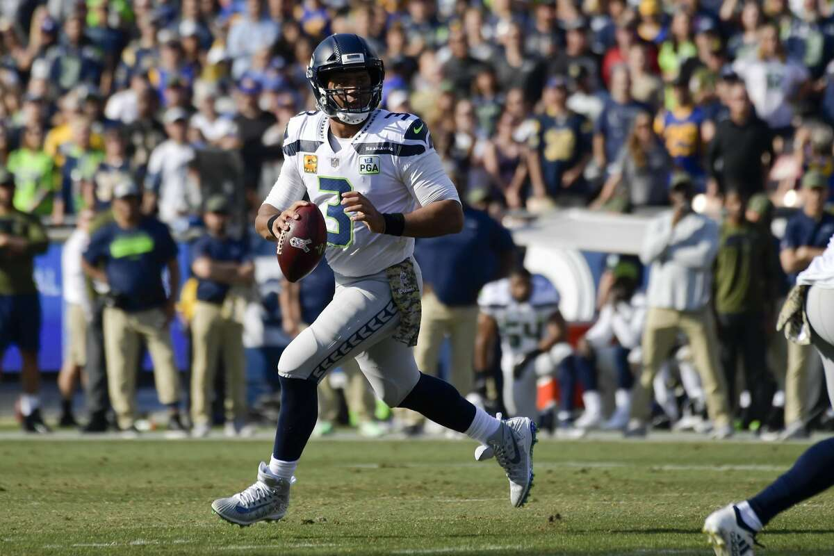 DESPITE MISCUES, RUSSELL WILSON WITH ANOTHER EFFICIENT GAME WITHOUT THROWING THE BALL TOO MUCH Wilson's performance Sunday resembled the Lions' game in Week 8: low passing numbers offset by the Seahawks' success running the ball. This time, however, Wilson got in on the action on the ground. Wilson completed 17 of 26 passes for 176 yards and three touchdowns with no picks -- an efficient clip. But he also rushed for a season-high 92 yards. It was his highest rushing total in four years (Wilson had 107 rushing yards in November of 2014 against the New York Giants).
