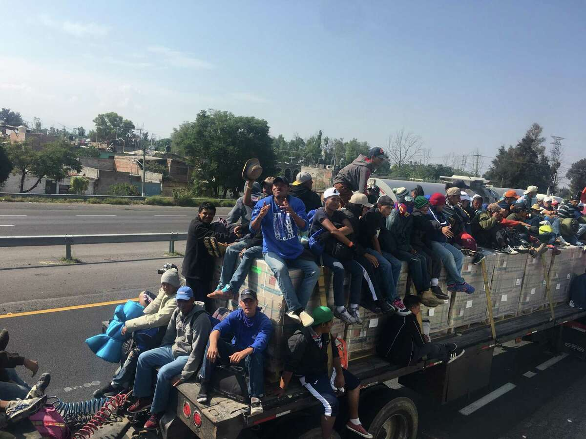 San Antonio clergyman Gavin Rogers flew to Mexico City over the weekend and joined a group of Hondurans in a migrant caravan who got a ride on a trailer.