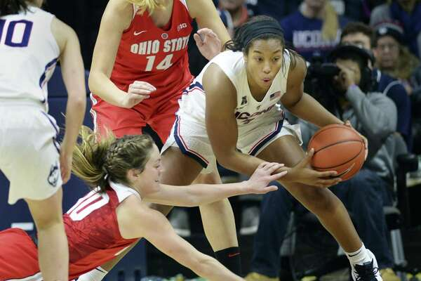UConn's Megan Walker, right, wins a rebound battle against Ohio State's Carly Santoro (10) in the second half on Sunday.
