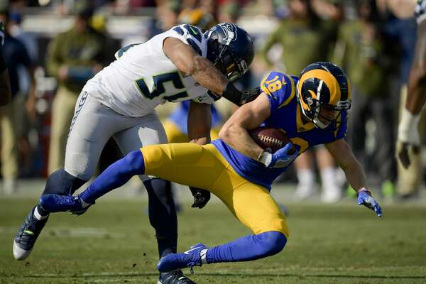 Los Angeles Rams wide receiver Cooper Kupp is tackled by Seattle Seahawks middle linebacker Bobby Wagner during the first half in an NFL football game Sunday, Nov. 11, 2018, in Los Angeles. (AP Photo/Mark J. Terrill)