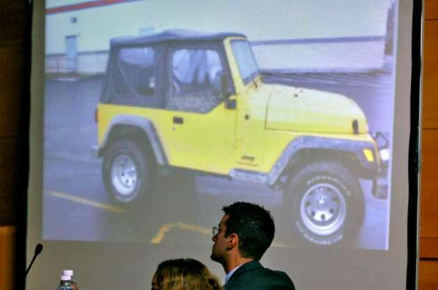 Christopher Porco sits below the projected image of an evidence photograph on Monday, July 17. The photo shows Porco's yellow Jeep after it was returrned to Albany following the crime.. Photo: Philip Kamrass