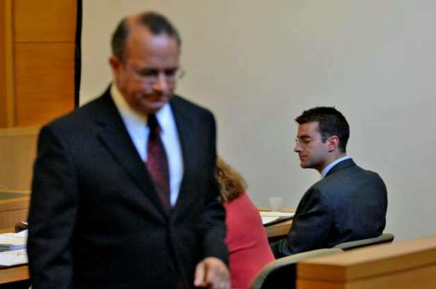 Joseph Catalano of Delmar walks out of the courtroom past defendant Christopher Porco in the Orange County Courthouse in Goshen on Monday, July 17. Photo: Philip Kamrass