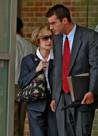 Christopher Porco escorts his mother Joan Porco from  the Orange County Courthouse in Goshen at lunch during the third day of jury selection on Wednesday June 28, 2006. Photo: Philip Kamrass