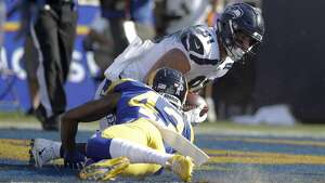 Seattle Seahawks tight end Nick Vannett scores past Los Angeles Rams strong safety John Johnson during the first half in an NFL football game Sunday, Nov. 11, 2018, in Los Angeles. (AP Photo/Alex Gallardo)