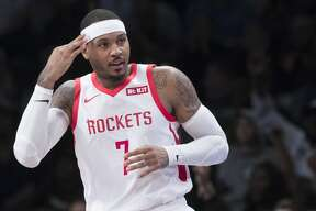 Houston Rockets forward Carmelo Anthony (7) reacts after scoring a three-point basket in the second half of an NBA basketball game against the Brooklyn Nets, Friday, Nov. 2, 2018, in New York. (AP Photo/Mary Altaffer)