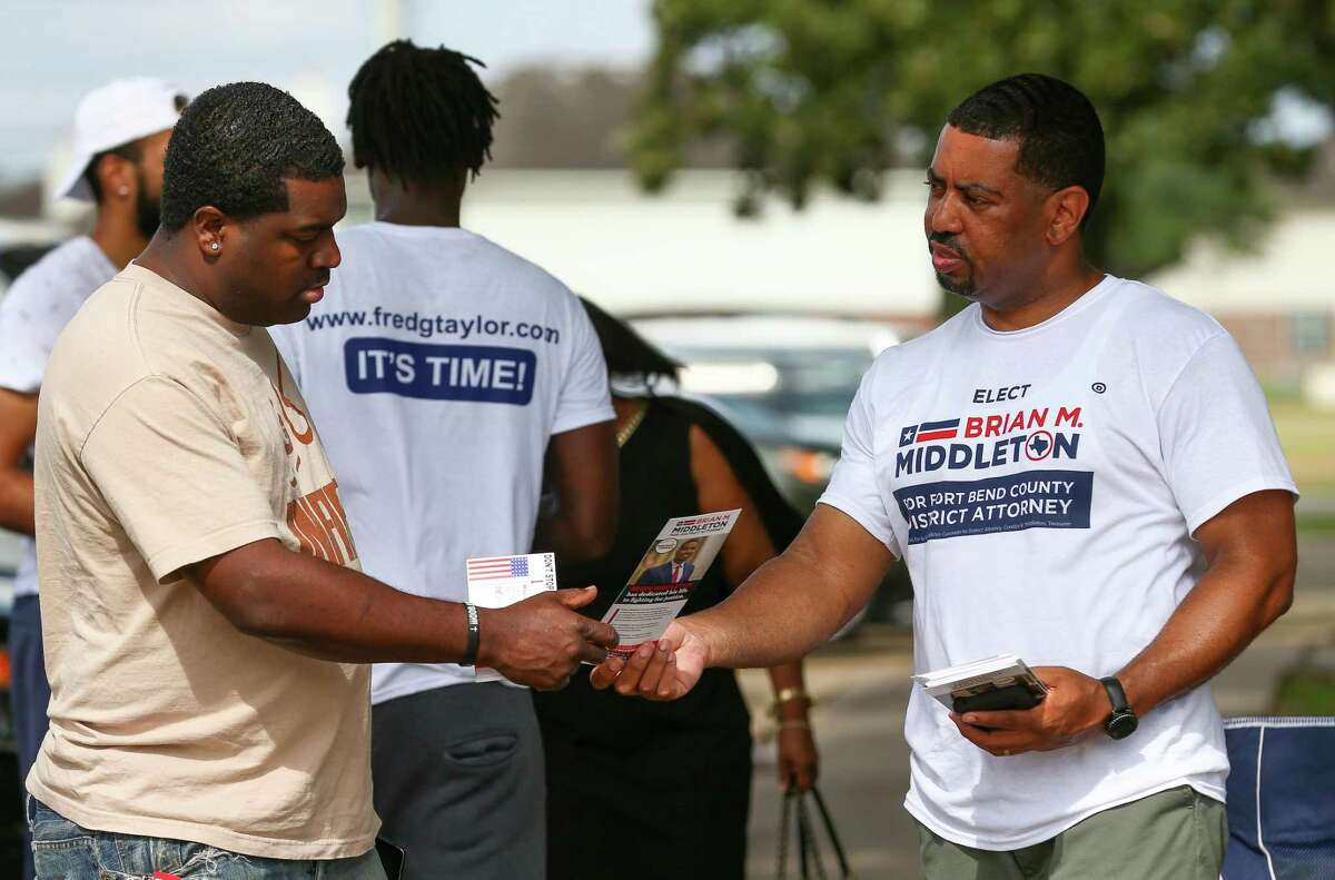 Fort Bend County District Attorney-elect Brian Middleton talked and handed out campaign literature to a voter outside the Missouri City Community Center on Election Day on Tuesday, Nov. 6, 2018.