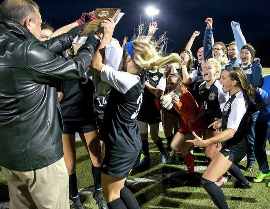 Members of the Lewis and Clark Community college women's soccer team celebrate after receiving the Central District Tourney championship plaque from LCCC athletic director Doug Stotler, far left, following their win over Southwestern Illinois College at McKendree University's Leemon Field. LCCC, the No. 7 seed, will play at the NJCAA Division I National Championships this week in Foley, Alabama. Photo: Jan Dona | For The Telegraph