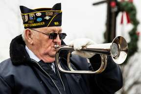 Bob Bauder, bugler for the Honor Guard, takes part in a Veterans Day ceremony on Saturday, Nov. 11, 2018 at the Veterans Memorial in downtown Midland. (Mackenzie Brockman/for the Daily News)