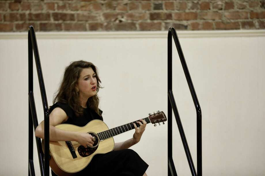 """Kendra McKinley sings """"Boys Will Be Boys"""" during the three-day installation """"Romantic Songs of the Patriarchy"""" at the Women's Building. Visitors to the exhibition are surrounded by song. Photo: Yalonda M. James / The Chronicle / San Francisco Chronicle"""