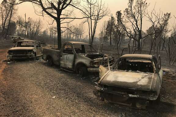 The vehicles of five residents who died while trapped in their cars fleeing the Camp Fire are seen at the end of Edgewood Lane in Paradise, Calif. Sunday, Nov. 11, 2018. Following reports that PG& and Southern California Edison equipment may be responsible for the Camp and Woolsey blazes, state Sen. Jerry Hill, D-San Mateo has called for legislation to break up the utilities or make them public entities.