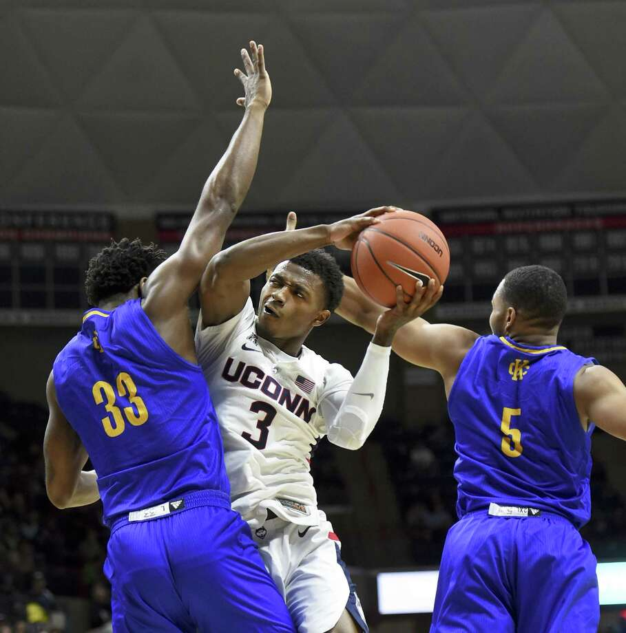 UConn's Alterique Gilbert (3) battles for position against UMKC's Marvin Nesbitt Jr. (33) and UMKC's Jordan Giles (5) in the first half Sunday. Photo: Stephen Dunn / Associated Press / Copyright 2018 The Associated Press. All rights reserved