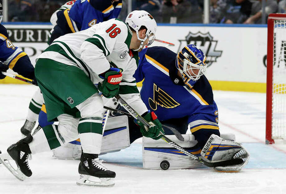 The Wild's Jason Zucker (16) is unable to score past Blues goaltender Chad Johnson during the third period Sunday in St. Louis. The Wild won 3-2. Photo: Associated Press