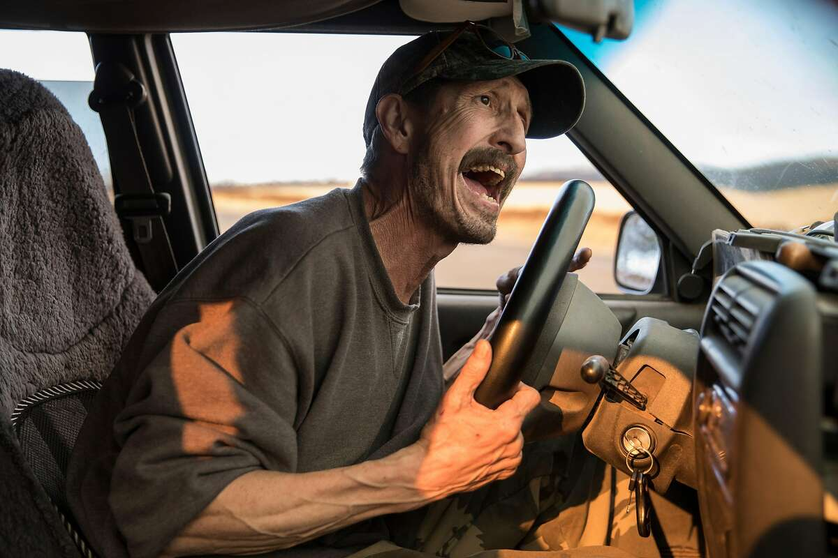 Greg Woodcox recounts his harrowing escape from Edgewood Lane from the Camp Fire in Paradise, Calif. while sitting in his Jeep watching the fire from Chico Airport in Chico, Calif. Sunday, Nov. 11, 2018