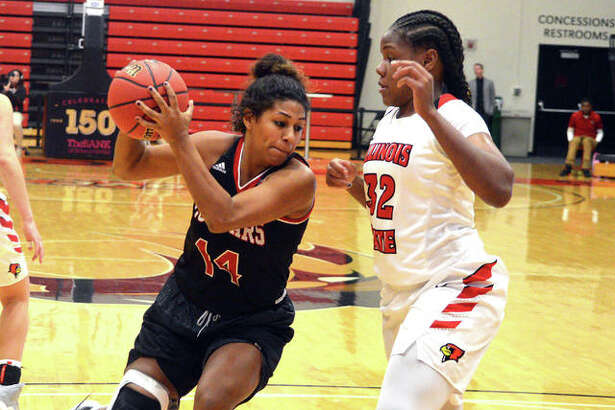 SIUE redshirt senior Micah Jones, left, tries to drive past Illinois State's Simone Goods during the first half of Sunday's game at Vadalabene Center.